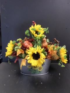 Sunflowers in a Metal Container
